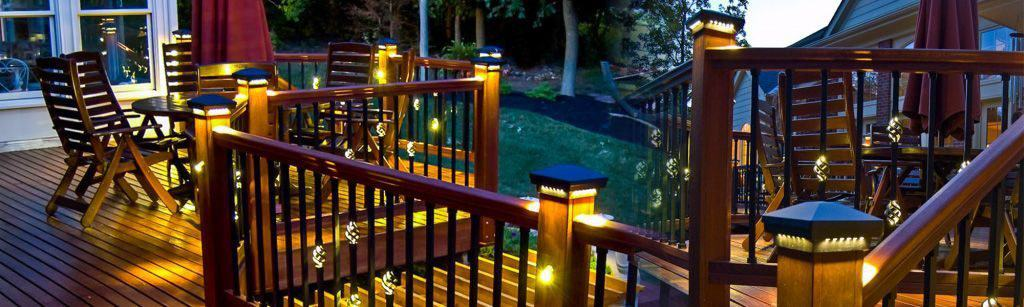 Wood deck featuring LED post cap lights