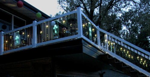 Festive deck lighting: glass panels with lights and etchings